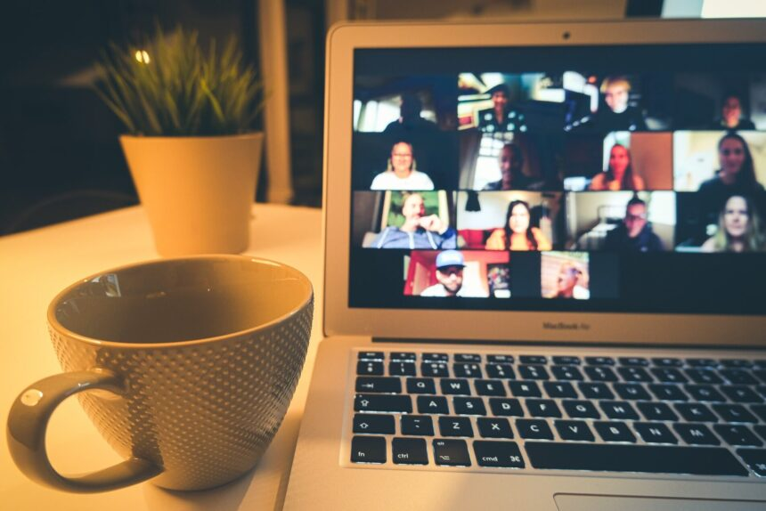 a cup and a laptop with a video call ongoing