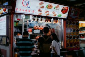 People queuing in front of a Singapore food stall
